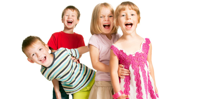 Group of children having fun, playing, screaming.