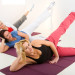 Women doing exercices on mat