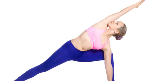 Sporty beautiful young blond woman doing lunge exercise, standing in Extended Side Angle posture, studio full length isolated shot, profile view on white background, part of large photo series